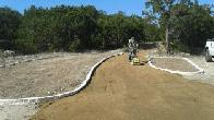 Gary Evensen compacting granite at trailhead (click to enlarge)