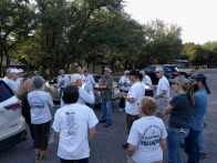 Volunteers listening at the parking lot (click to enlarge)