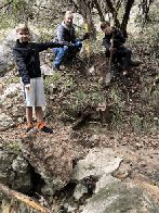Aidan, Terry and Tyler move a boulder (click to enlarge)