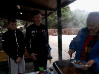 Judy serving hot stew to Aidan and Tyler (click to enlarge)